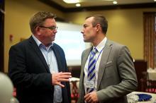 Tom Martin of EKU, left, talks with UK's Ian McClure