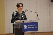 photo of Lexington Mayor Linda Gorton at podium with UK logo