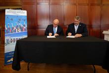 photo of UK Provost David W. Blackwell and Somerset Community College President Carey Castle signing a memorandum of understanding with the University Center of Southern Kentucky.  Mark Cornelison | UK Photo.