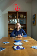 photo of Bobbie Ann Mason seated at end of dining table