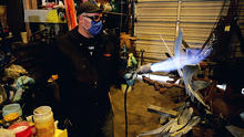photo of Jeremy Colbert working on sculpture