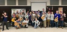 photo of participants in Modern Band Workshop holding guitars