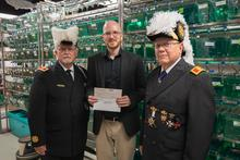 photo of Knights Templar presenting Oliver Voecking with check