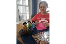 Russell County 4-H'er Autumn Onyon shows off the Hino dolls she made as part of 4-H's virtual celebration of Japan's Girls' Day.