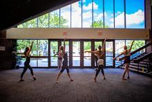 photo of 4 dancers at GSA in Singletary lobby