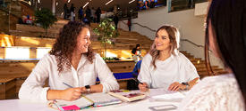 Two students working in the Gatton Student Center.