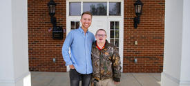 Brack Duncan and Josh Banks outside the FarmHouse fraternity house