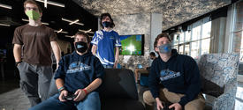 Four students at Cornerstone playing esports in the UK Federal Credit Union Esports Lounge..