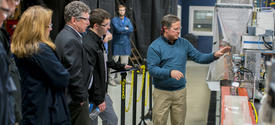 photo of Matt Weisenberger, associate director of UK CAER's Carbon Materials Technologies Group, showcases the center's unique carbon fiber spinning capabilities.