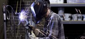 photo of student in Fine Arts Institute metalworking class
