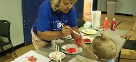 UK student helps kid fingerpaint