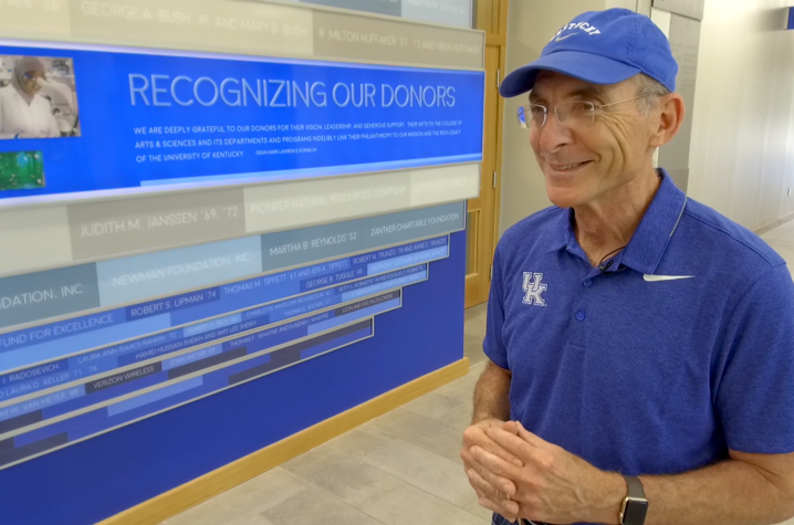 UK President Eli Capilouto in front of donor wall inside Jacobs Science Building