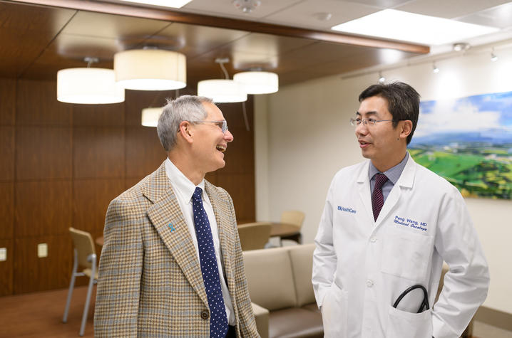 Charles Lutz and Peng Wang
