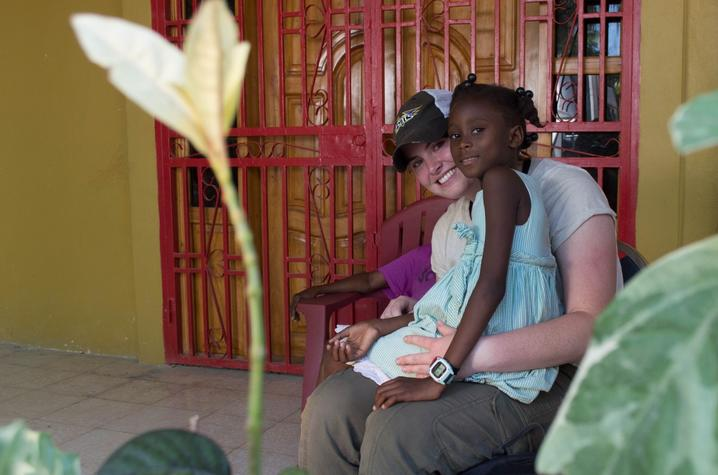 photo of UK student and child at Haiti orphanage