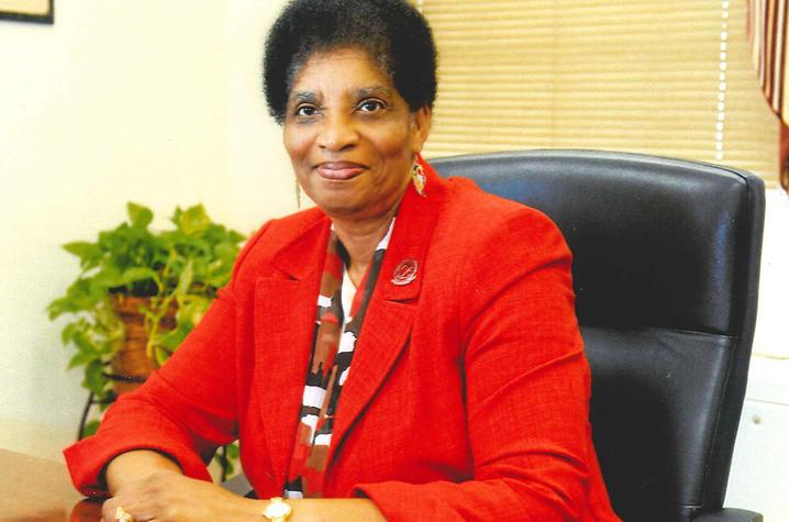 photo of Retia Scott Walker at desk