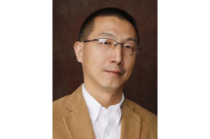 headshot photo of George Zhang