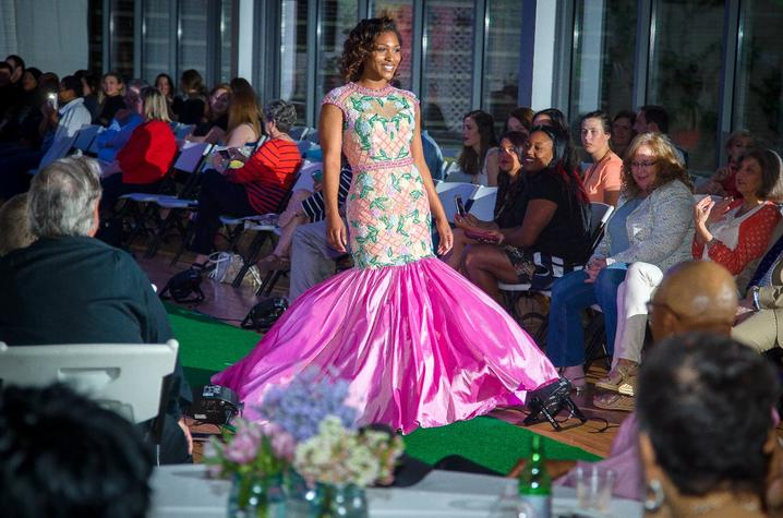 photo of student modeling dress in Color Me Spring fashion show