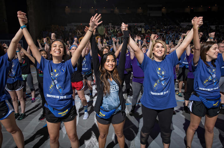 Students hold hands during DanceBlue 2019