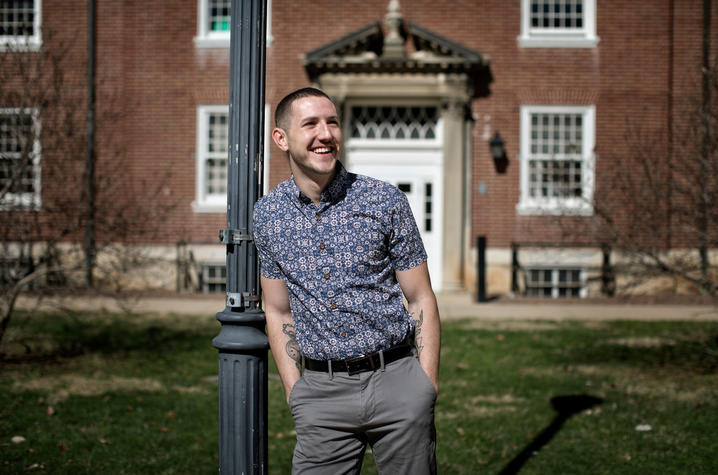Photo of Trey Cardwell stands leaning in front of a brick building in the Breckinridge Courtyard Photo by Mark Cornelison | UK Photo
