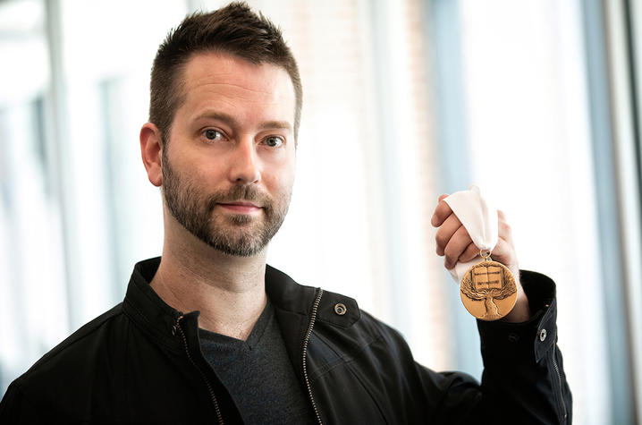photo of Lennon Michalski holding medal