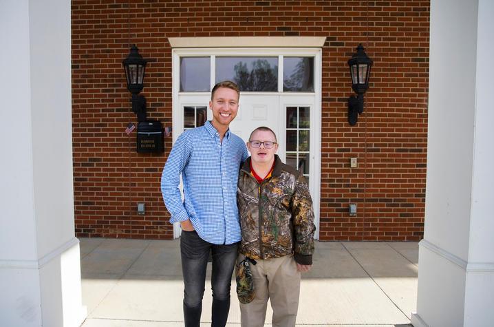Brack Duncan and Josh Banks outside the FarmHouse fraternity house
