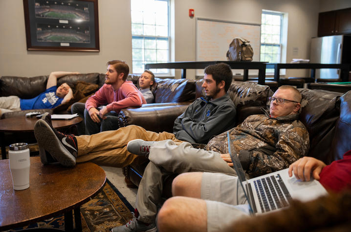 Josh enjoys hanging out with his fraternity brothers at FarmHouse