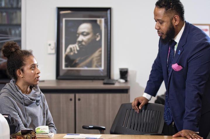 Jason Brooks counsels a student