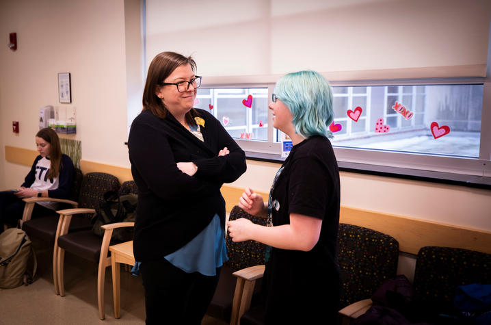 photo of Dr. Caryn Sorge with a patient in the clinic