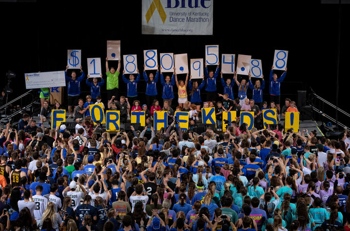 DanceBlue participants holding up total amount of money raised