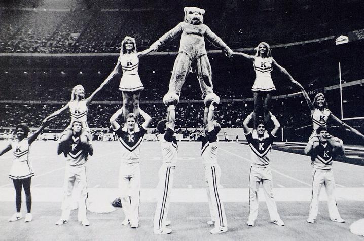 black and white photo of UK Cheerleaders in pyramid from 1985 Kentuckian