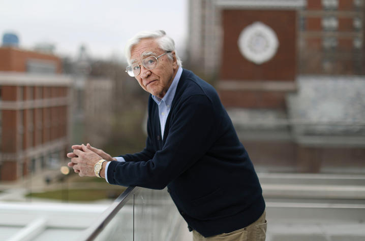 photo of Bob Lawson  taken on Law College landing with Memorial Hall and campus behind him