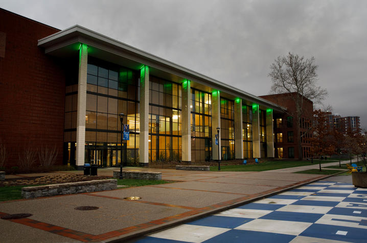 photo of Jacobs Science Building lit in green