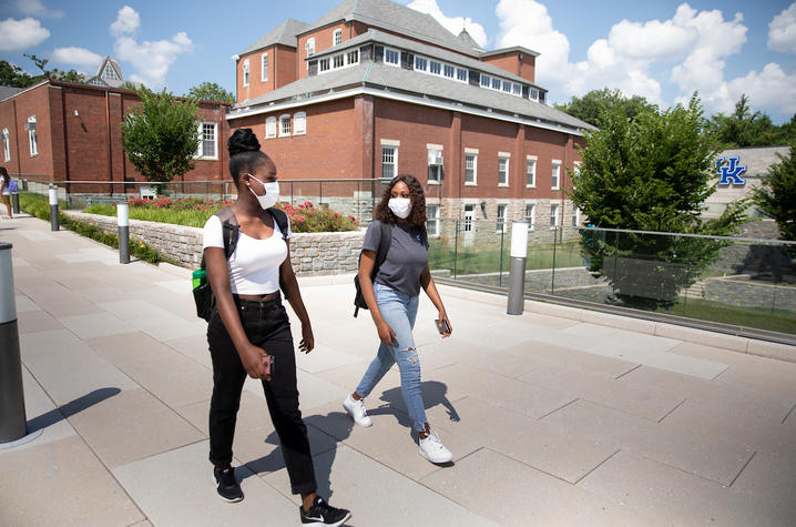photo of two students walking on campus
