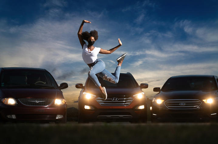 "photo of Connor Perry dancing in front of cars illuminated by cars for ""Once Vacant"""