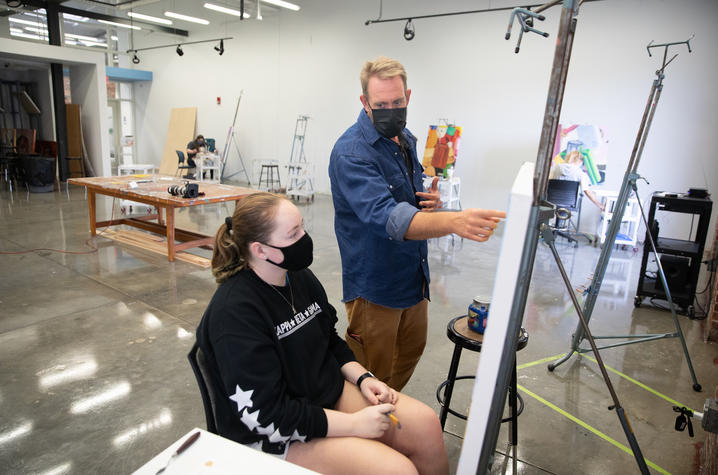 Photo of Painting I class instructor teaching student