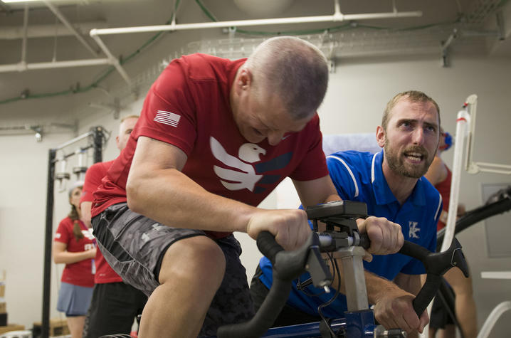 An 'Eagle Athlete' works alongside Dr. Nick Heebner in the UK Sports Medicine Research Institute facility