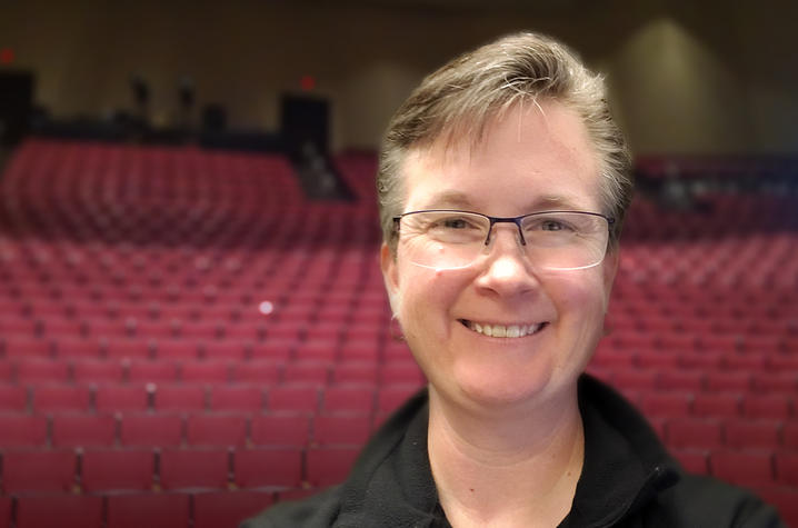 photo of Tanya Harper with Singletary Center Concert Hall seats behind her