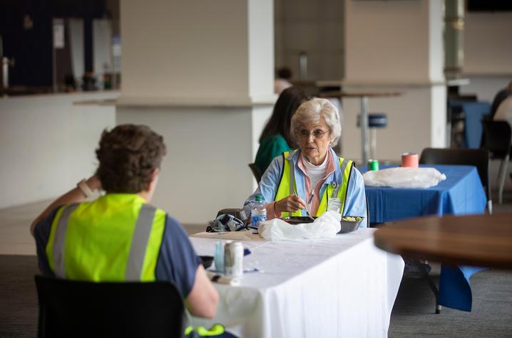 Photo of vaccine clinic volunteers receiving lunch