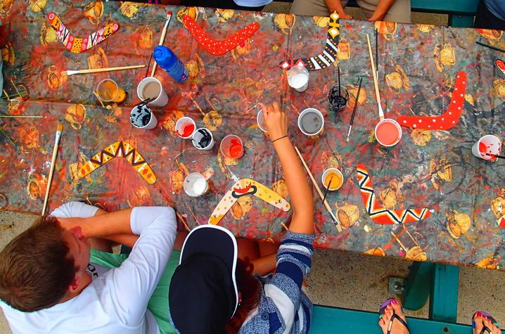 Exchange students in Australia paint boomerangs