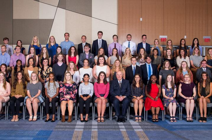 photo of 2018-2019 scholarship recipients with Fritz Skeen, the president of the UK Alumni Association, center.