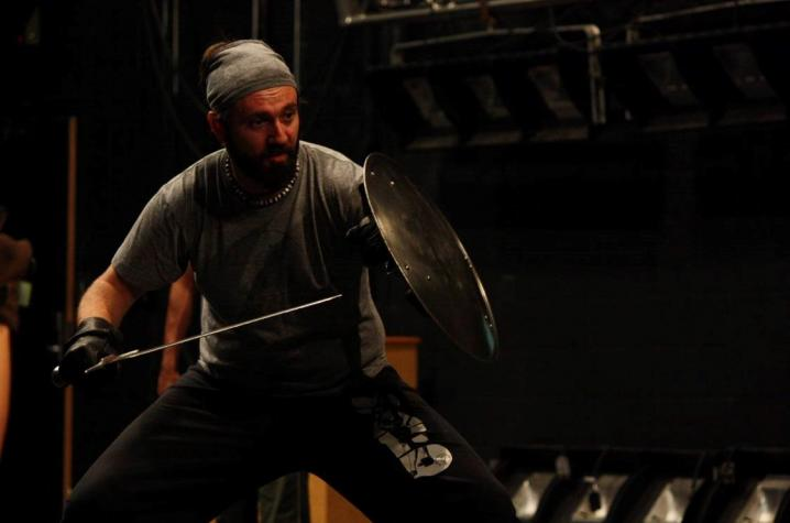Andrew Dylan Ray with shield and sword
