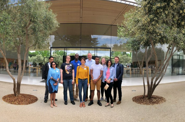 Students and staff standing in front of Apple's Enterprise Design Lab.