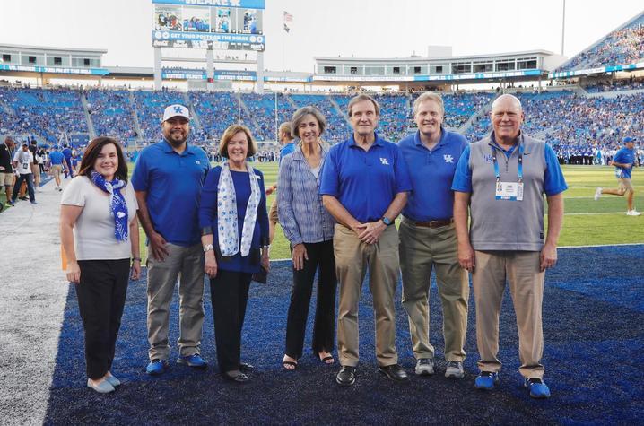 photo on Kroger Field of Jennifer Greer, Julian Vasquez Heilig, Rossetta Sandidge, Mary Davis, Jeffrey Okeson, Derek Lane, and Provost David Blackwell.