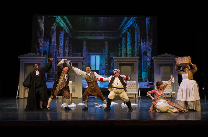 "photo of fight scene in UK Opera Theatre's ""The Barber of Seville"""