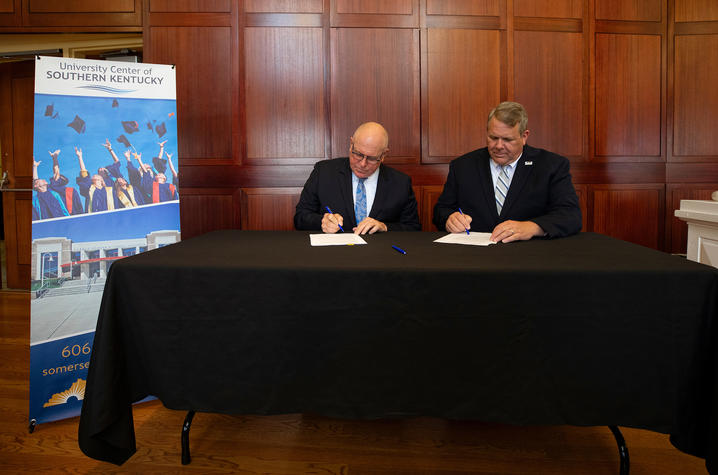 photo of UK Provost David W. Blackwell and Somerset Community College President Carey Castle signing a memorandum of understanding with the University Center of Southern Kentucky.  Mark Cornelison | UK Photo.