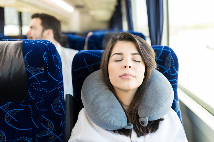 Woman taking a nap on a bus.
