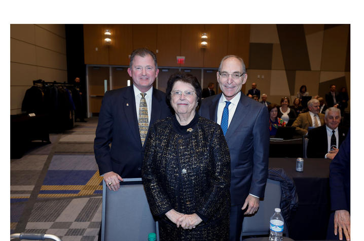 photo of UK Board of Trustees Chair Britt Brockman, philanthropist Mira Ball, and President Eli Capilouto following the board's acceptance of Ball's $10 million gift.