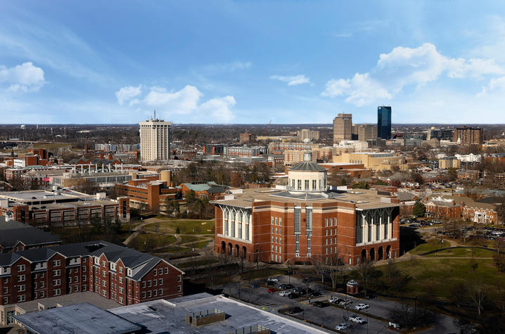 aerial photo of UK's campus with W.T. Young Library in center and downtown Lexington in back