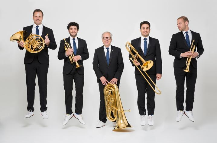 photo of Canadian Brass with instruments jumping