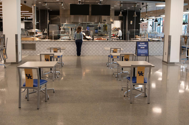 photo of Champions Kitchen during pandemic with tables spaced out for physical distancing